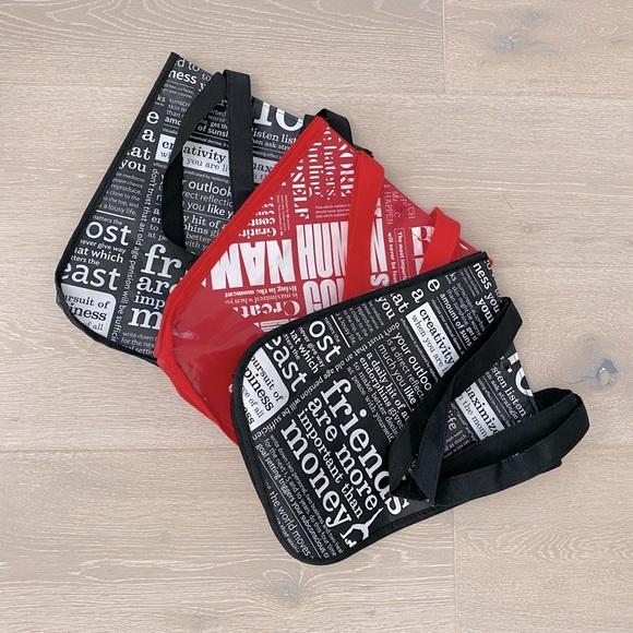 Set of three small Lululemon shopping bags